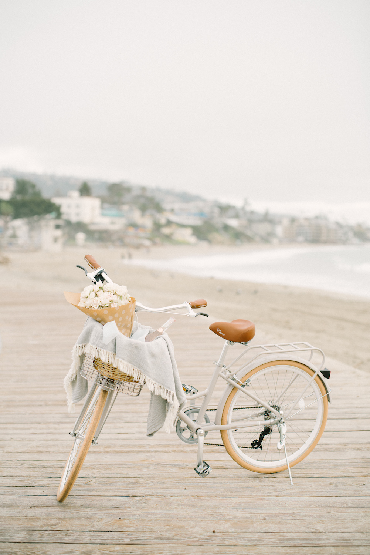 Blooms & beach cruiser basket by Compass Floral.  Design & Planning // Events by Talissa Photographer // Garrett Richardson