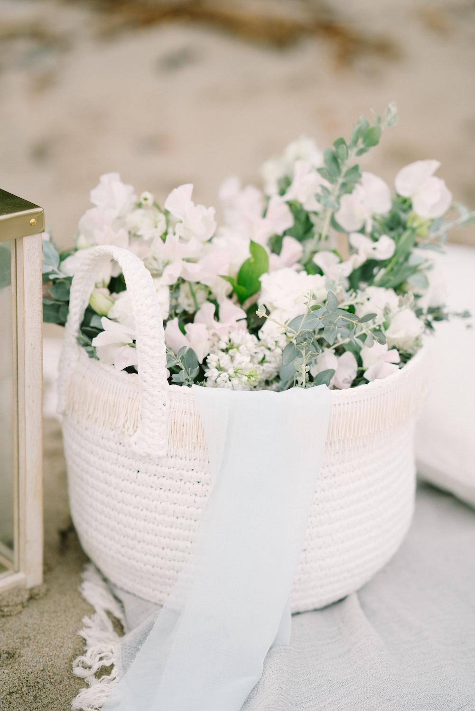 Summer florals in basket by Compass Floral.  Design & Planning // Events by Talissa Photographer // Garrett Richardson