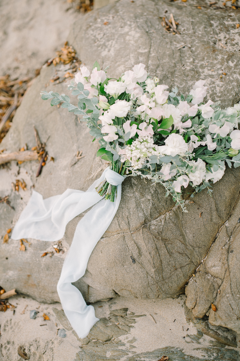 Neutral summer bouquet of lilac, sweet pea and lisianthus by Compass Floral.  Design & Planning // Events by Talissa Photographer // Garrett Richardson