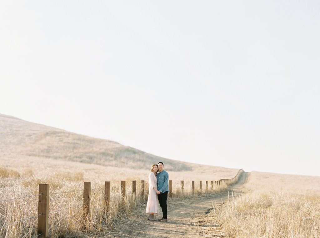 Dreamy golden hour field engagement photo session |Compass Floral | Wedding Florist in San Diego and Southern California | Meiwen Wang Photography    #gardenromantic       #sandiegowedding    #sandiegoweddingflorist       #orangecountyflorist     #floraldesign       #dreamwedding    #fineartwedding    #fineartflowers    #fineartcuration    #weddingdetails    #weddinginspiration    #engaged #engagementphotos #fieldphotos #dreamyphotos #goldenhour #engagementphotooutfitinspiration
