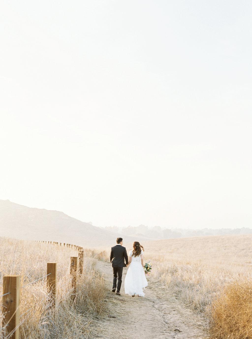 Dreamy golden hour field engagement photo | Bouquet by Compass Floral | Wedding Florist in San Diego and Southern California | Meiwen Wang Photography    #gardenromantic       #sandiegowedding    #sandiegoweddingflorist       #orangecountyflorist     #floraldesign       #dreamwedding    #fineartwedding    #fineartflowers    #fineartcuration    #weddingdetails    #weddinginspiratio   n #engaged #engagementphotos #engagementphotooutfitinspiration #fieldphotos #dreamyphotos #goldenhour  #engagementphotobouquet