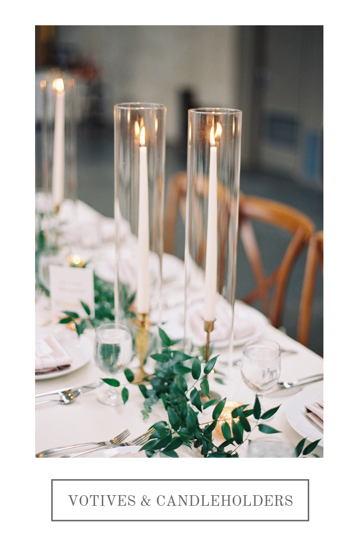 Taper candles in brass candlesticks   Compass Floral   Wedding Florist in San Diego and Southern California