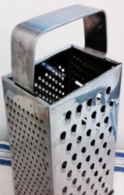 If your grater looks like this, use the holes on the left side.