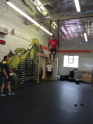 Lane whipping out Muscle Ups in 15.3