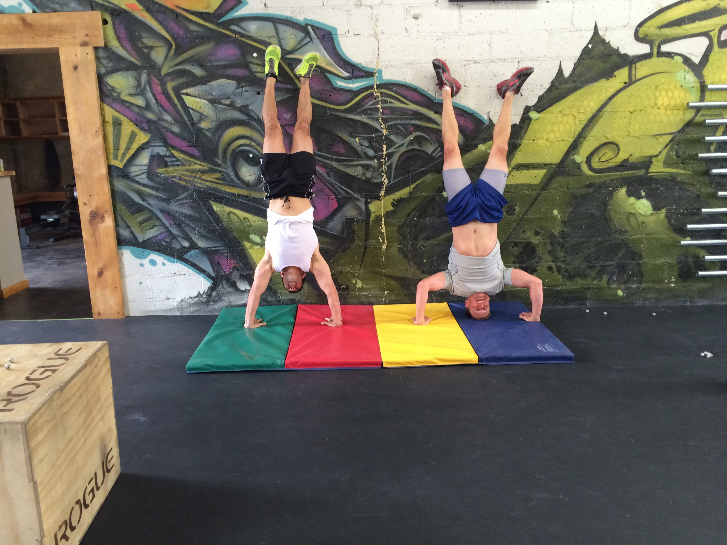 Tom and Beto working the Handstand Push ups last week.