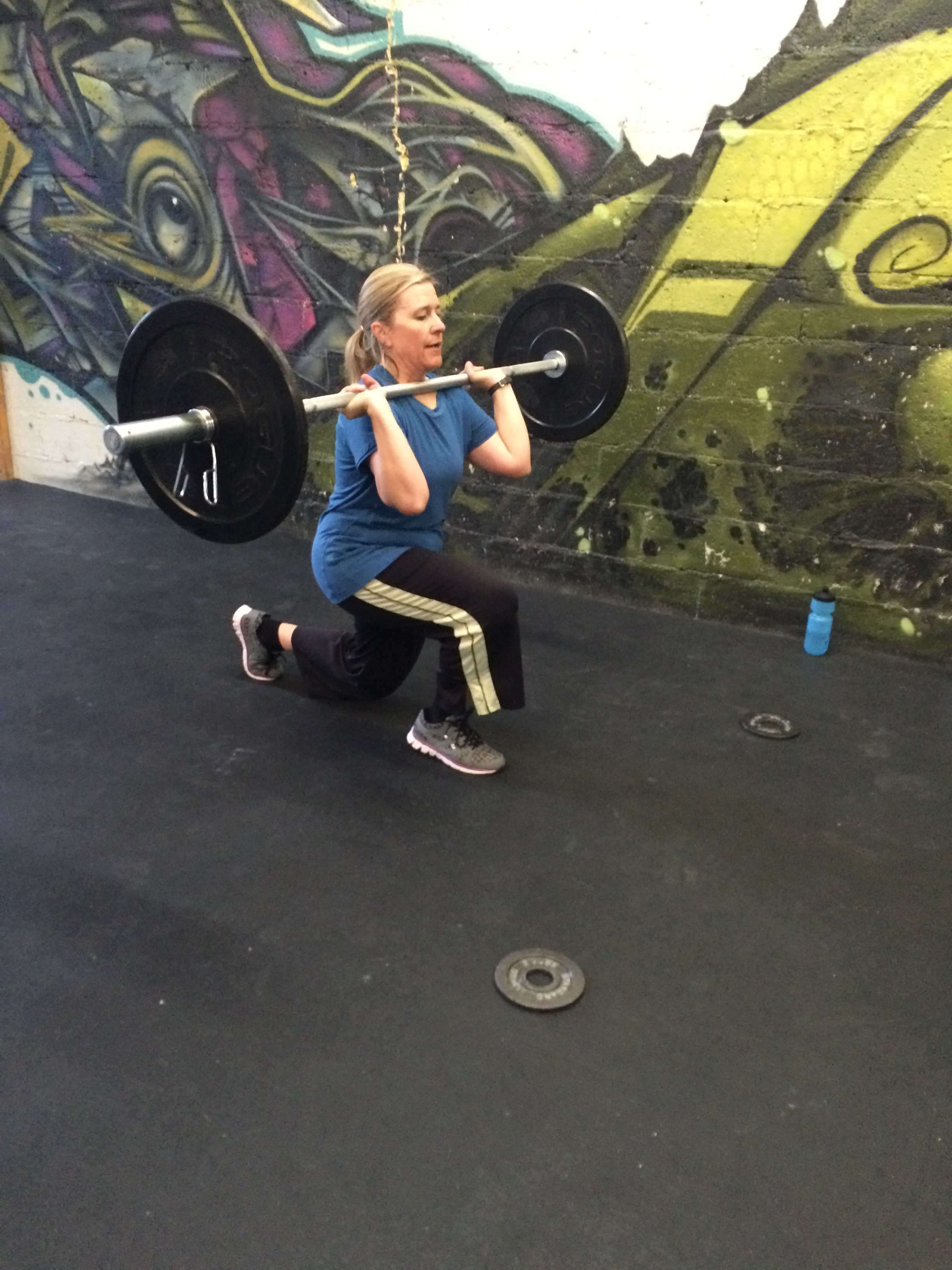 Kristen demonstrating some focus on front rack lunges last week. Shes probably thanking us for those right now as she is on a backcountry ski trip. Actually, she probably isn't thanking us.