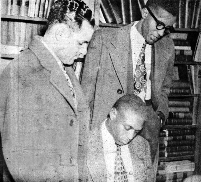 Silas Herbert Hunt filling out forms in the office of the dean of the University of Arkansas School of Law;February 2, 1948. With him are Harold Flowers (right) and Wiley Branton. Courtesy of the Arkansas State Archives and the Encyclopedia of Arkansas History & Culture.