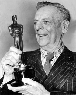 """In 1958, Max Aronson received an Honorary Academy Award as a """"motion picture pioneer"""" for his """"contributions to the development of motion pictures as entertainment."""""""
