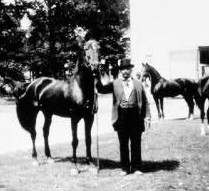 Wiley Jones (in top hat) at his stables with his horse Excalibur; circa 1890s. Courtesy of the Arkansas State Archives.