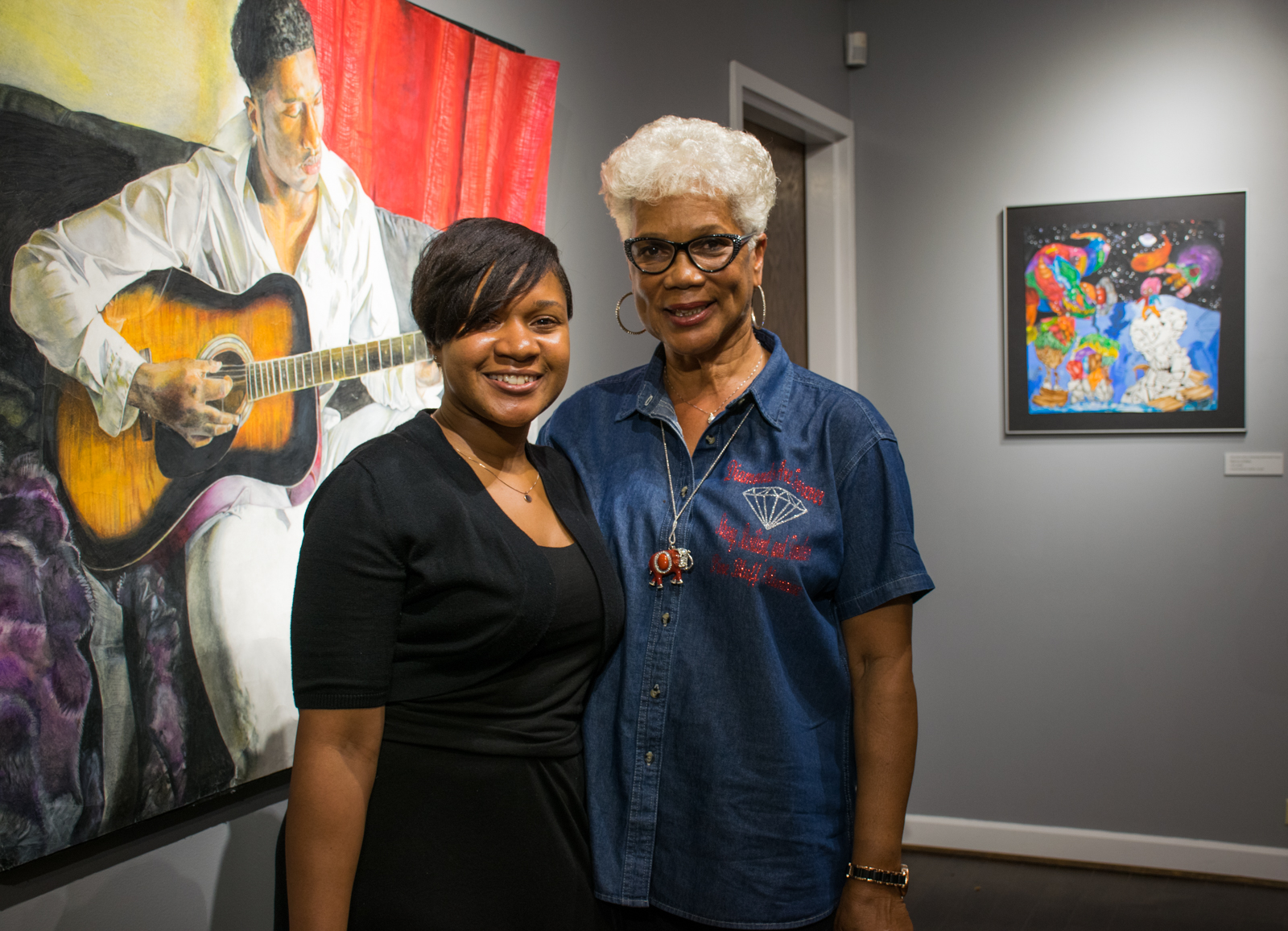 Pine Bluff High School teacher Shalisha Thomas (left), curated the 2018 exhibit of her students' works. She took over from Virginia Hymes (right), who retired last year after more than 40 years of teaching. Thomas is herself a former student of Hymes.
