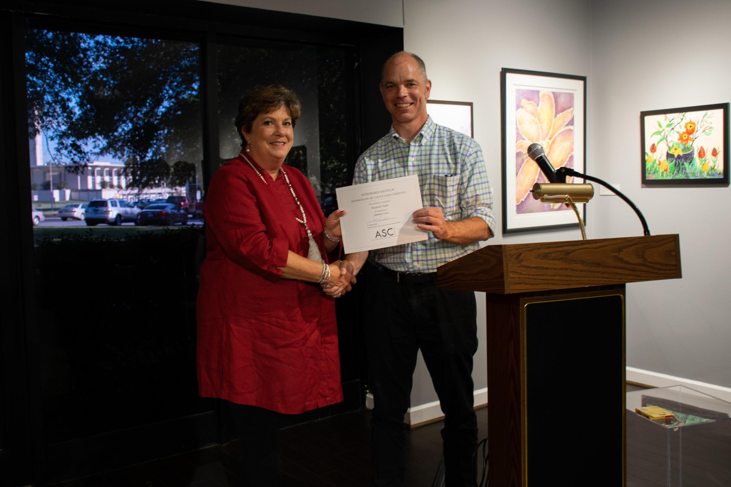 "Elizabeth Sadler won an Honorable Mention for her acrylic panting ""Autumn Grove."" Juror John Kushmaul announced the winners."