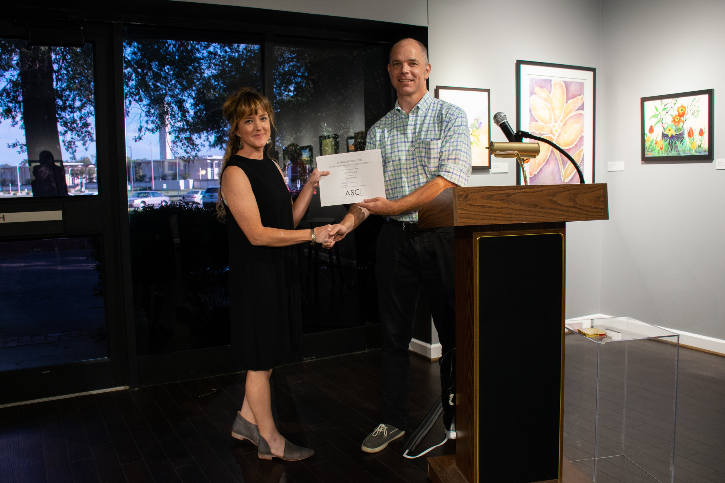 """Crystal Jennings won an Honorable Mention: for her graphite drawing """"Nightbloomers."""" Juror John Kushmaul announced the winners."""