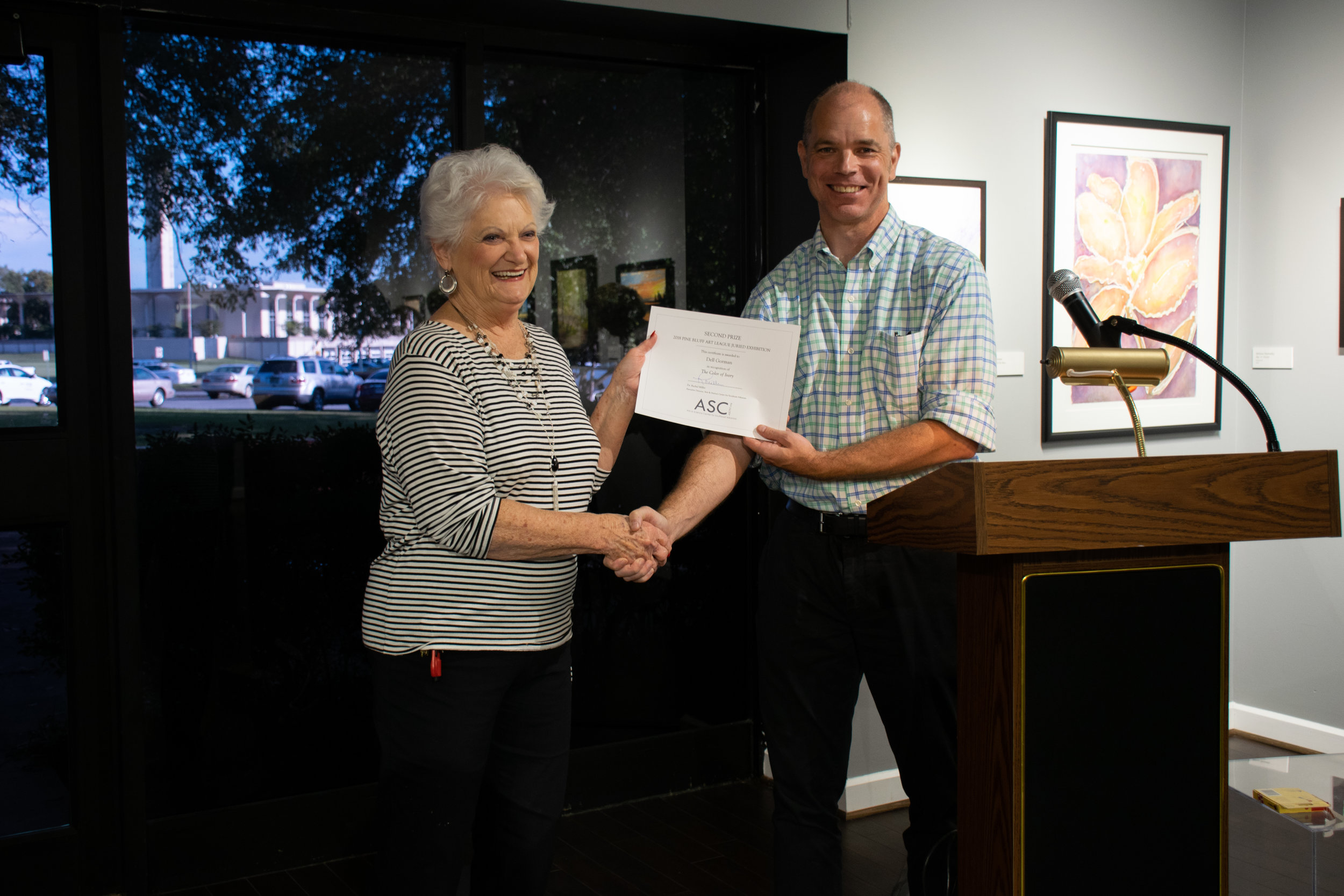 """Dell Gorman won Second Place for her acrylic painting """"The Color of Ivory."""" Juror John Kushmaul announced the winners."""