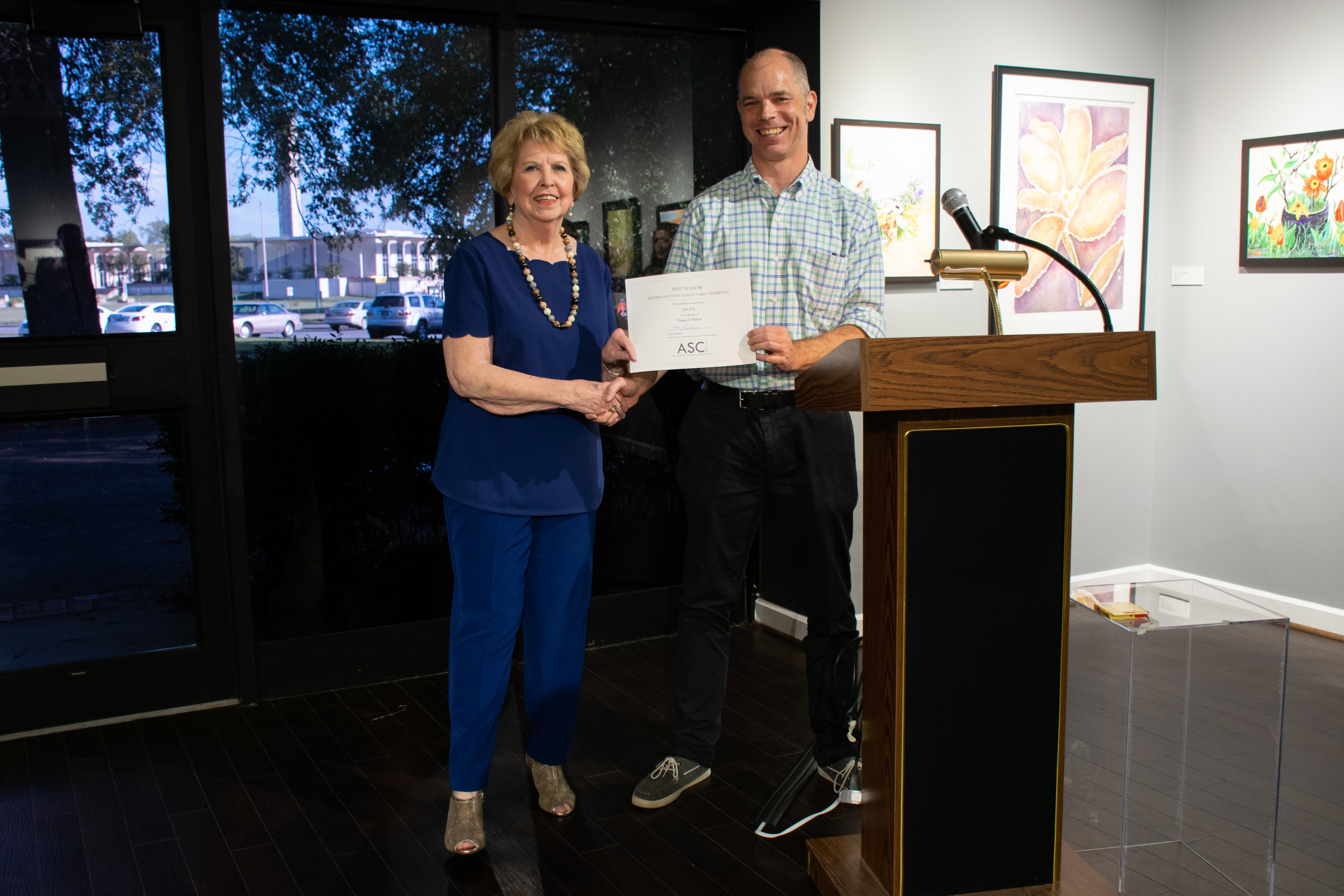 """Inis Ray won Best in Show for her oil and acrylic painting """"Focus on Flowers."""" Juror John Kushmaul announced the winners."""