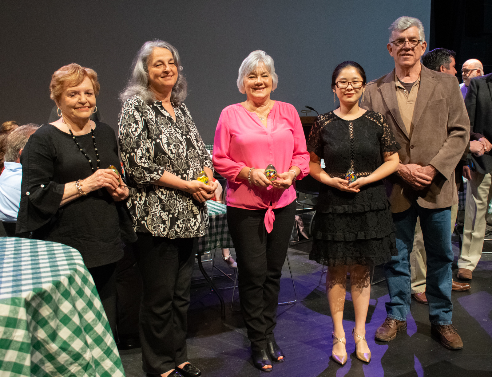 2019 Good Egg Awards recipients were Charlotte England (from left), Donna Oates, Pam Holcomb, Yunru (Rachel) Shinn and Bill Moss. The five were among those honored during the Arts & Science Center's Volunteer Night awards and reception on Thursday, April 11. The awards were crafted by glassmaker  James Hayes .­