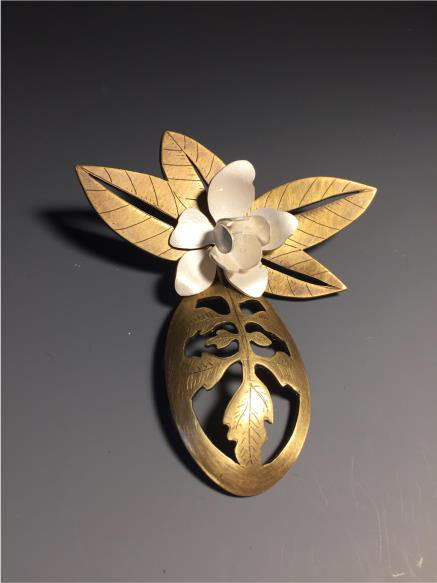 Amanda Heinbockel, For Mimi, 2017, sterling silver and brass. IMAGE COURTESY Arkansas Committee of the National Museum of Women in the Arts.
