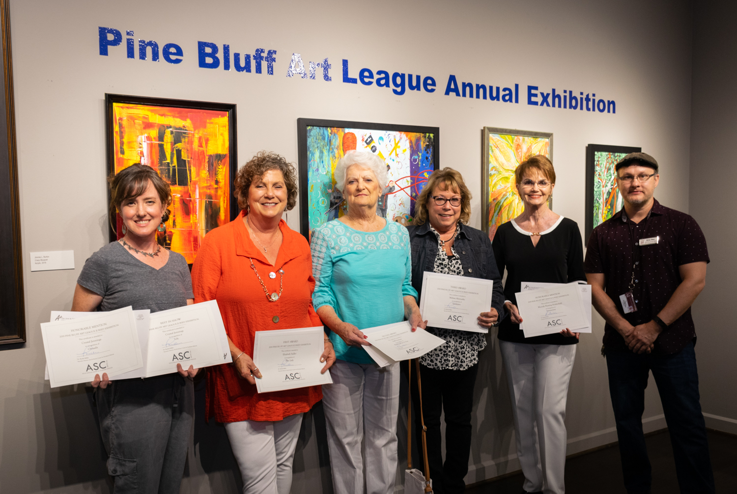 The winners of the 2019 Pine Bluff Art League Annual Exhibition are (from left) Crystal Jennings (Best in Show and Honorable Mention), Elizabeth Sadler (First Place), Dell Gorman (Second Place), Melissa Abernathy (Third Place), Rhonda Fleming Holderfield (Honorable Mention) and juror Ricky Sikes. The winners were announced during the exhibition's opening reception Thursday, Aug. 8, 2019, at The Arts & Science Center.
