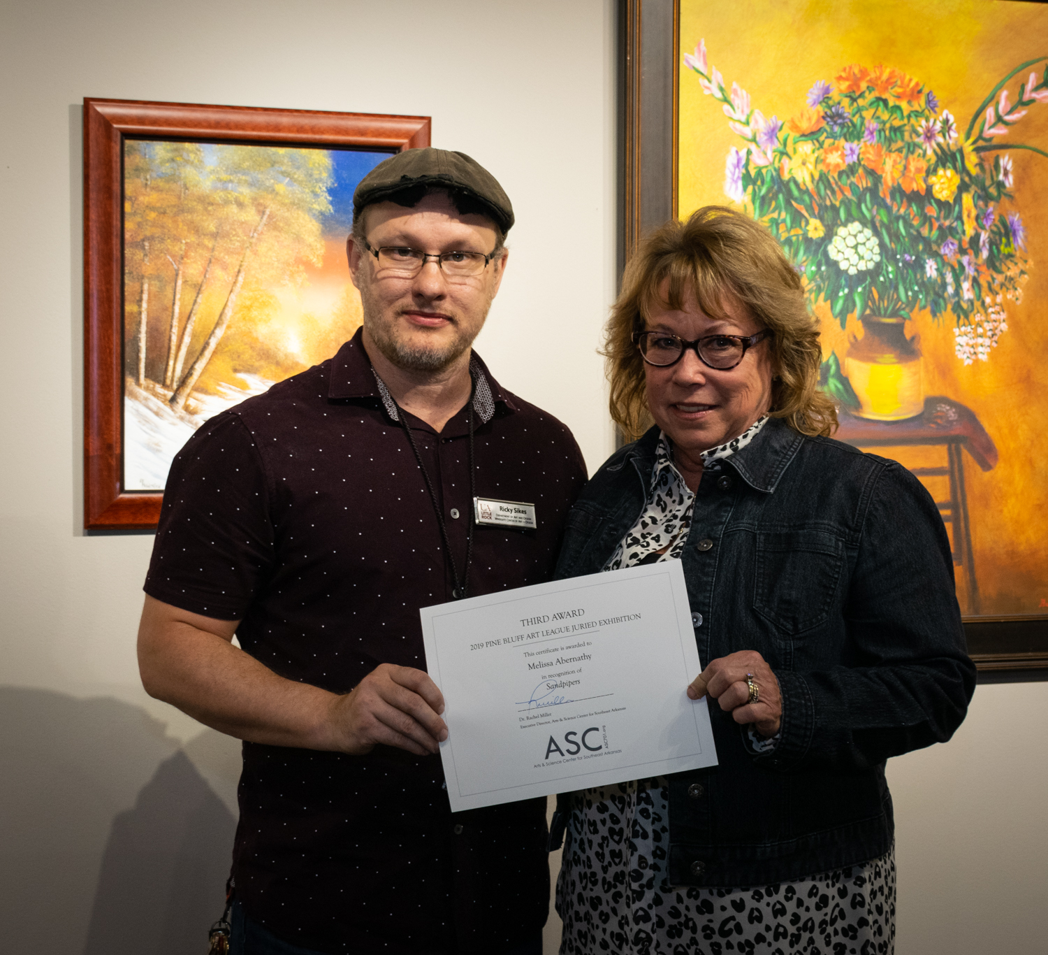 Melissa Abernathy (right, with juror Ricky Sikes) was awarded Third Place for her photograph  Sandpipers.