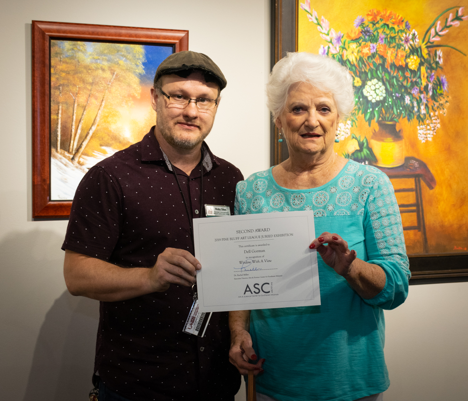 Dell Gorman (right, with juror Ricky Sikes) was awarded Second Place for her acrylic painting  Window With A View .