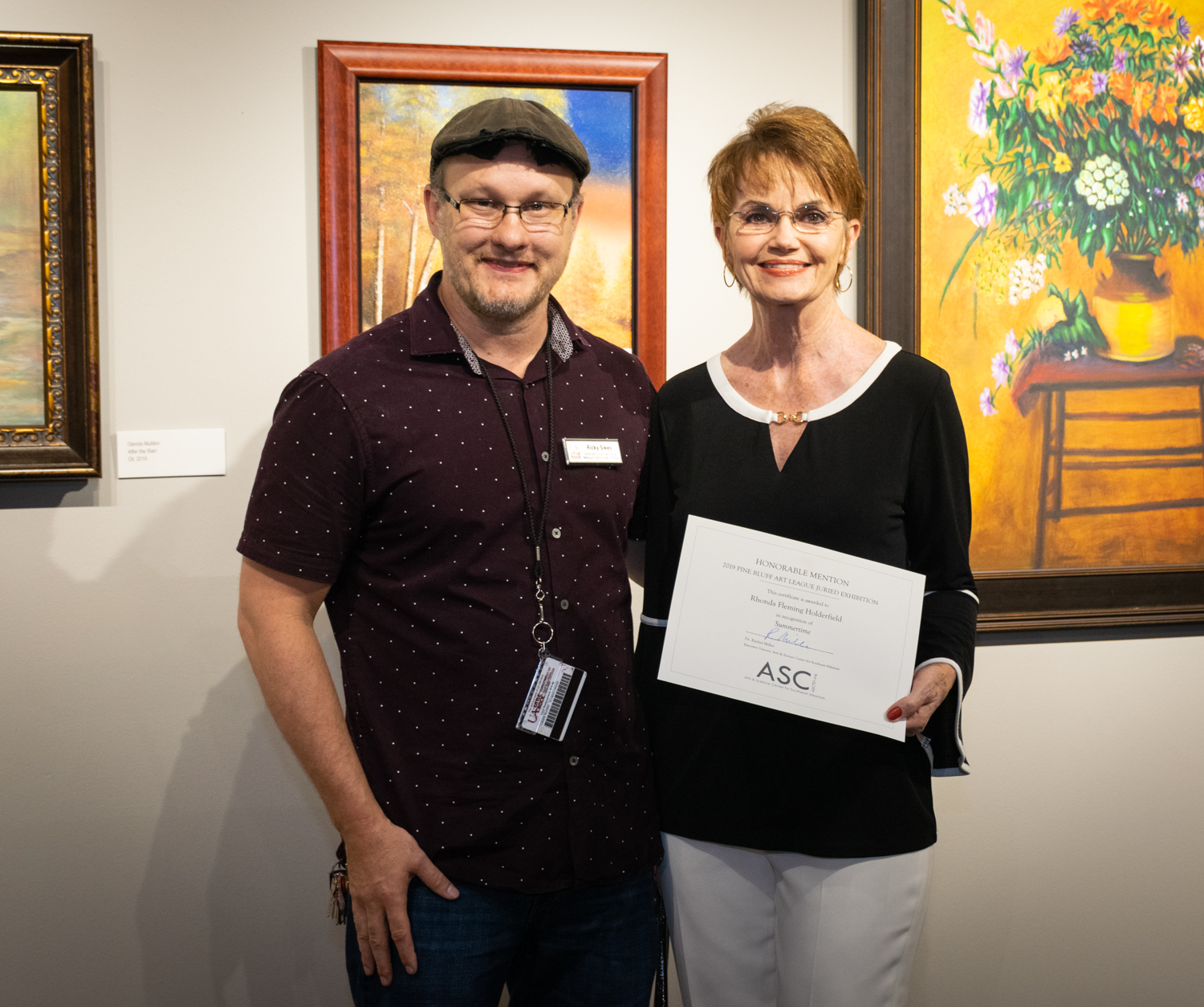 Rhonda Fleming Holderfield (right, with juror Ricky Sikes) was awarded an Honorable Mention for her acrylic painting Summertime.