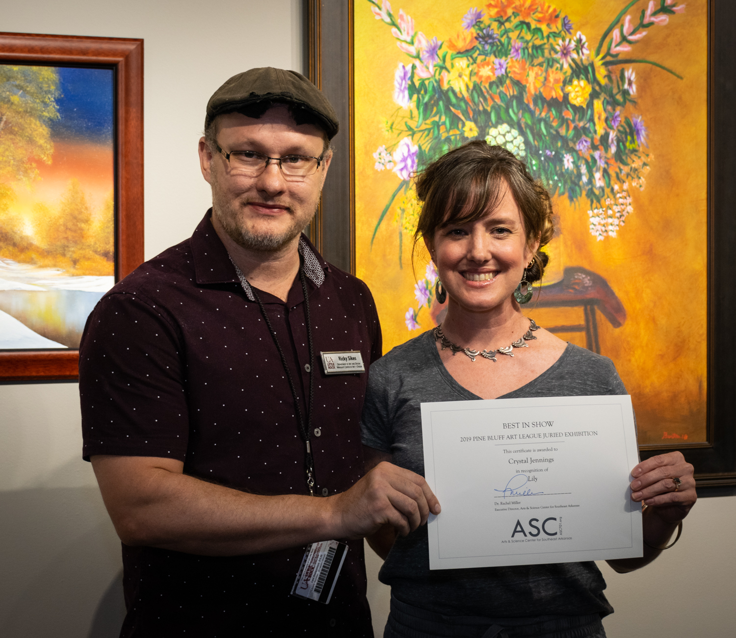 Crystal Jennings (right, with juror Ricky Sikes) won an Honorable Mention for her graphite drawing  Chrysalis .