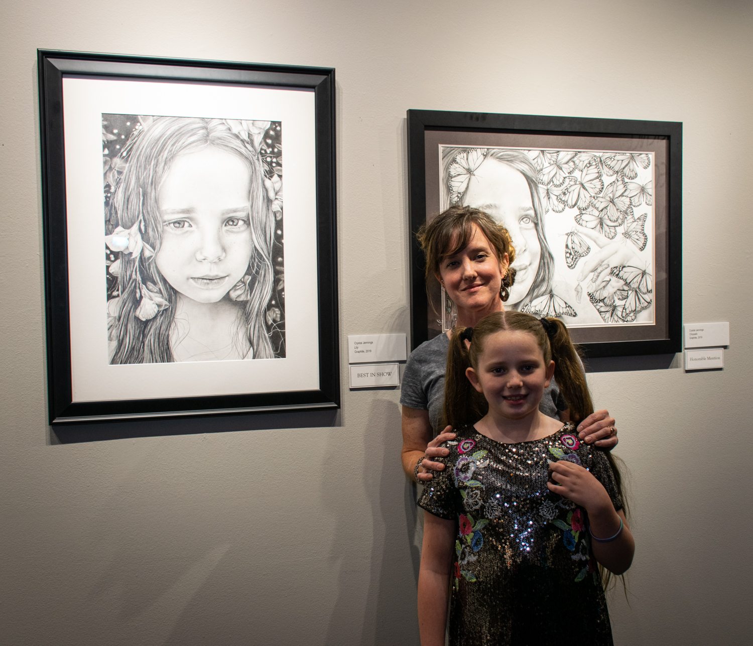Crystal Jennings with her daughter, Lily, model of her award-winning drawings.