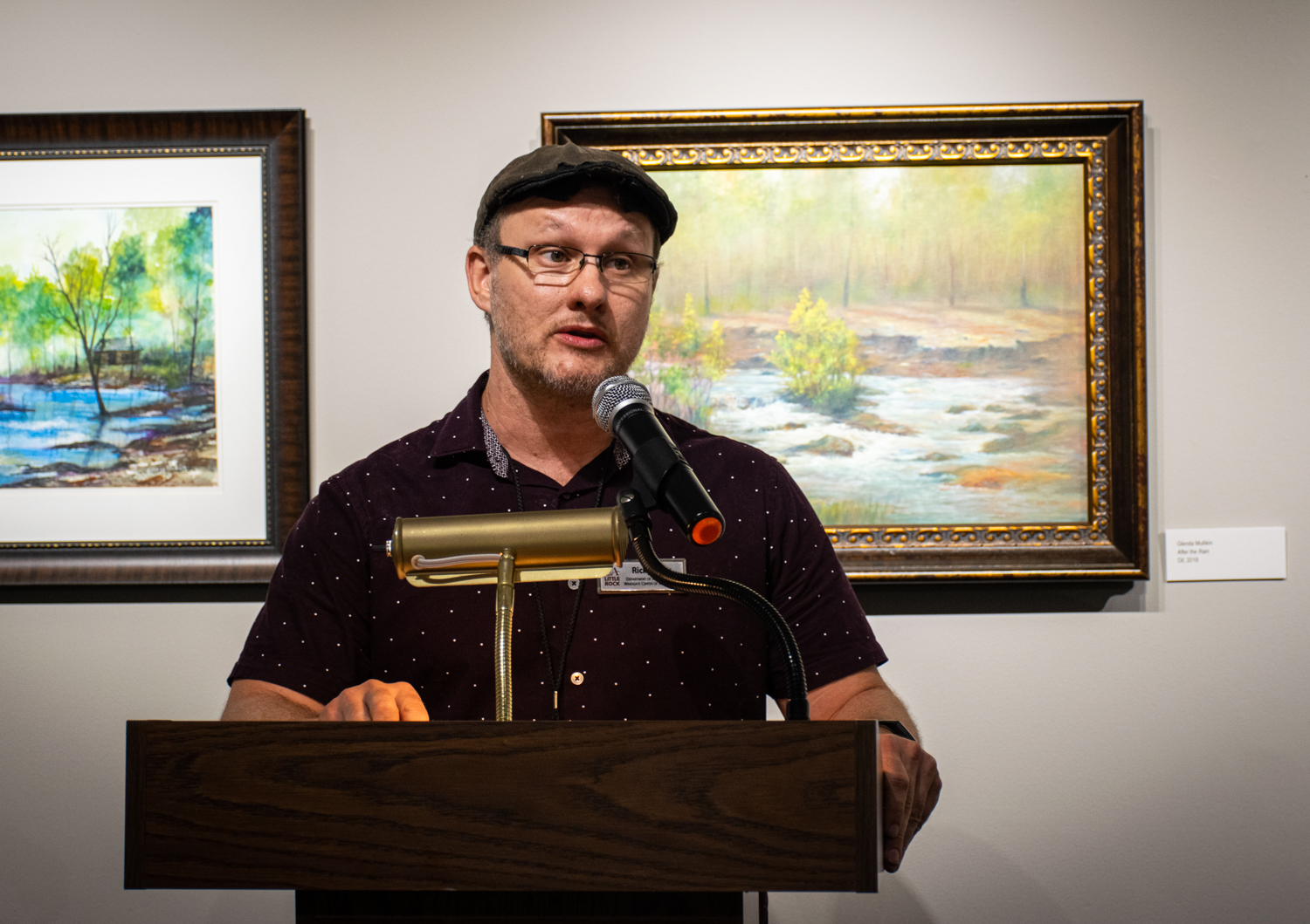 Juror Ricky Sikes, who is an artist-in-residence at University of Arkansas-Little Rock, speaks during the opening reception.