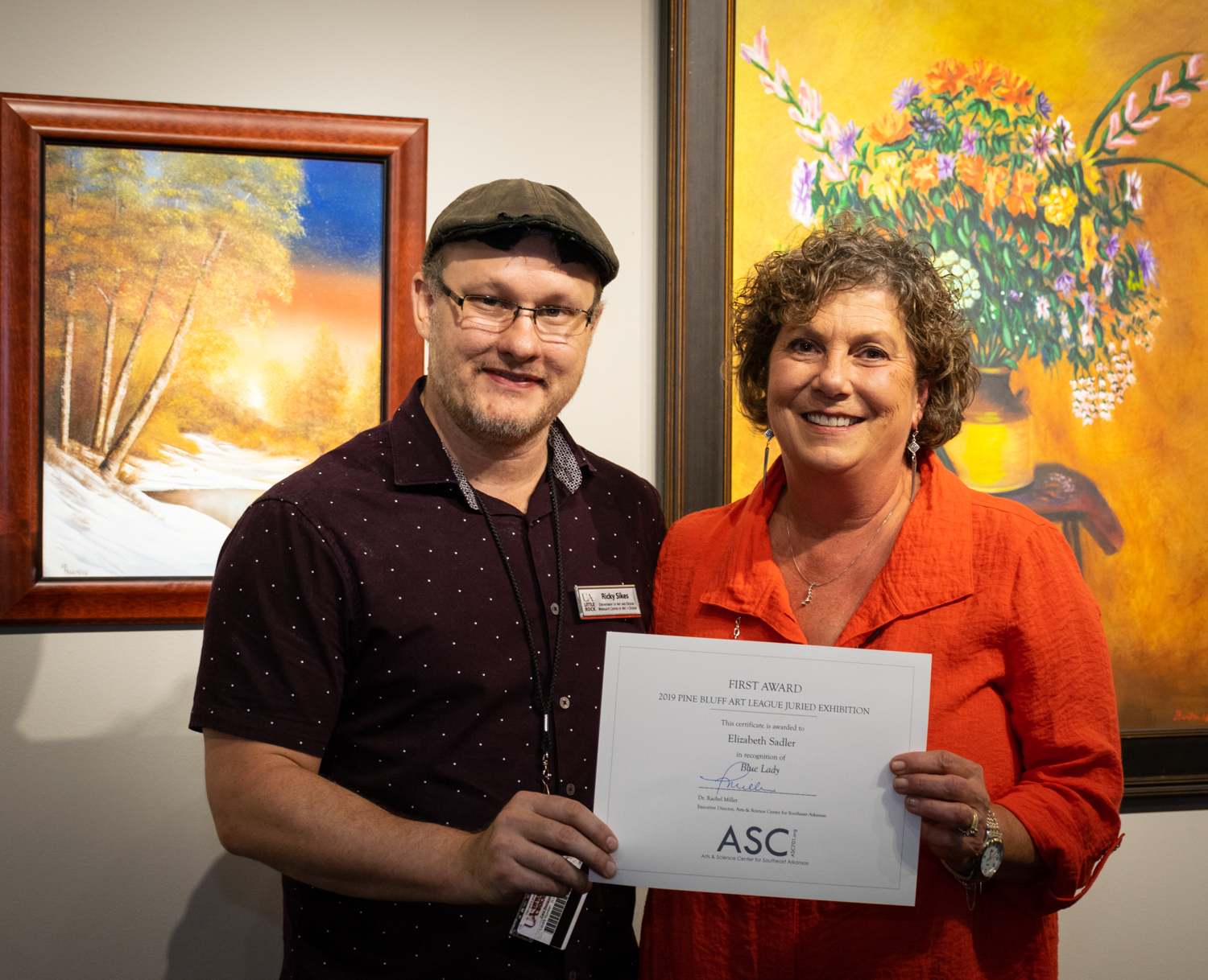 Elizabeth Sadler (right, with juror Ricky Sikes) was awarded First Place for  Blue Lady.