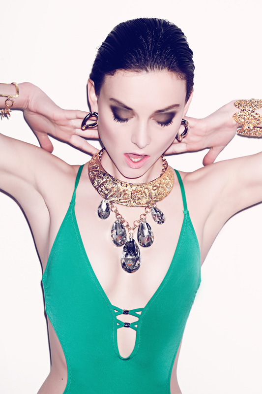 Earrings – Pluma               Collar and  Cuff on  Right – Clara Kasavina                Cuff on  Left – Julie Vos                Chandelier  Necklace – Gemma Simone                Bathing Suit – H&M