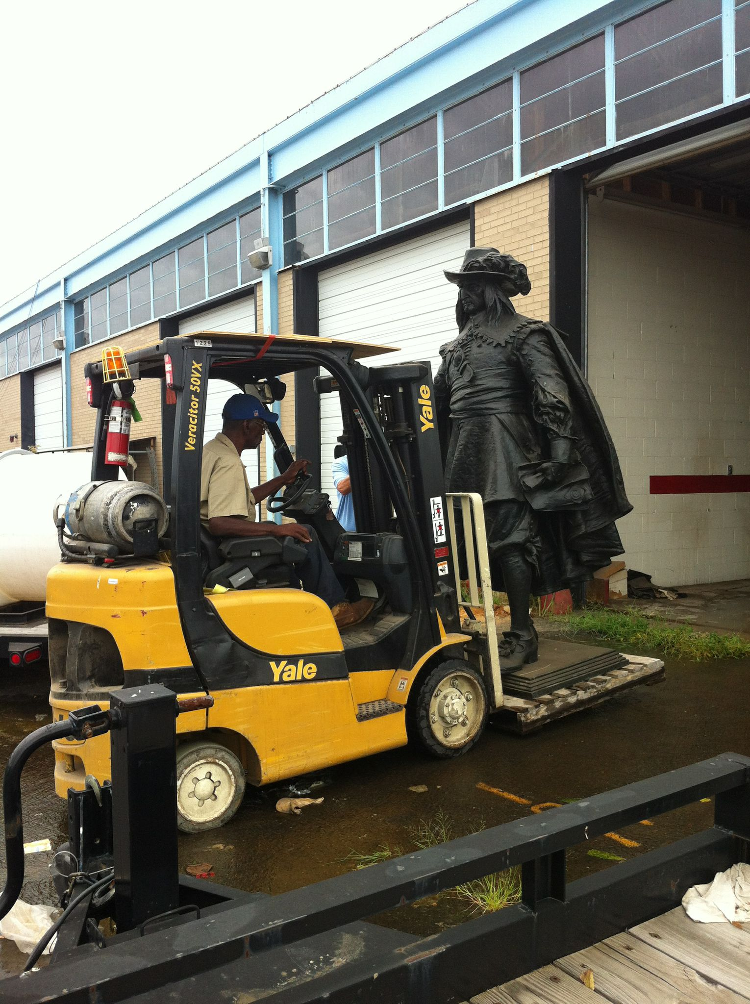 Removing Peter from storage for a final cleaning post restoration.