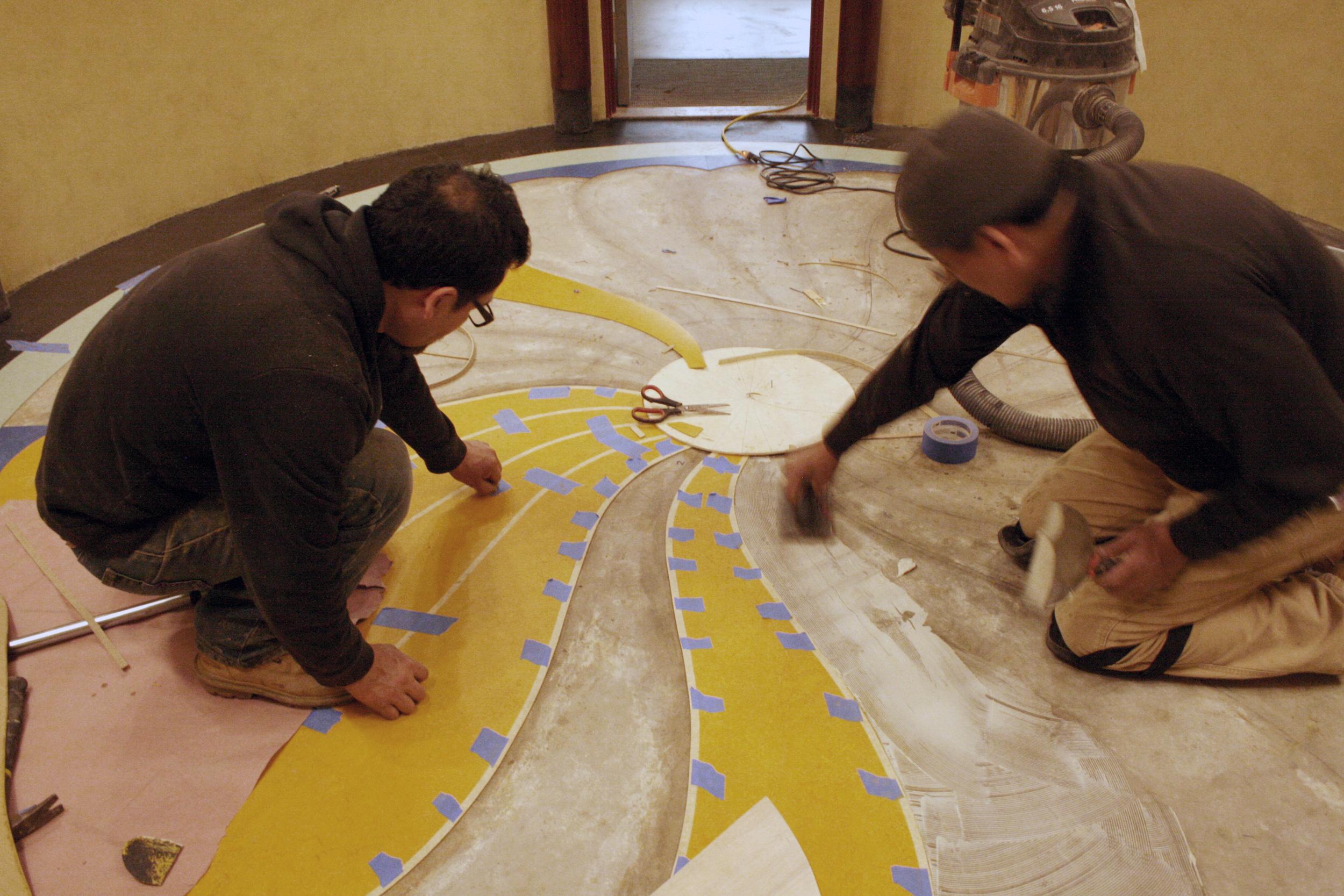 Installation of Powder Room inlaid linoleum floor.