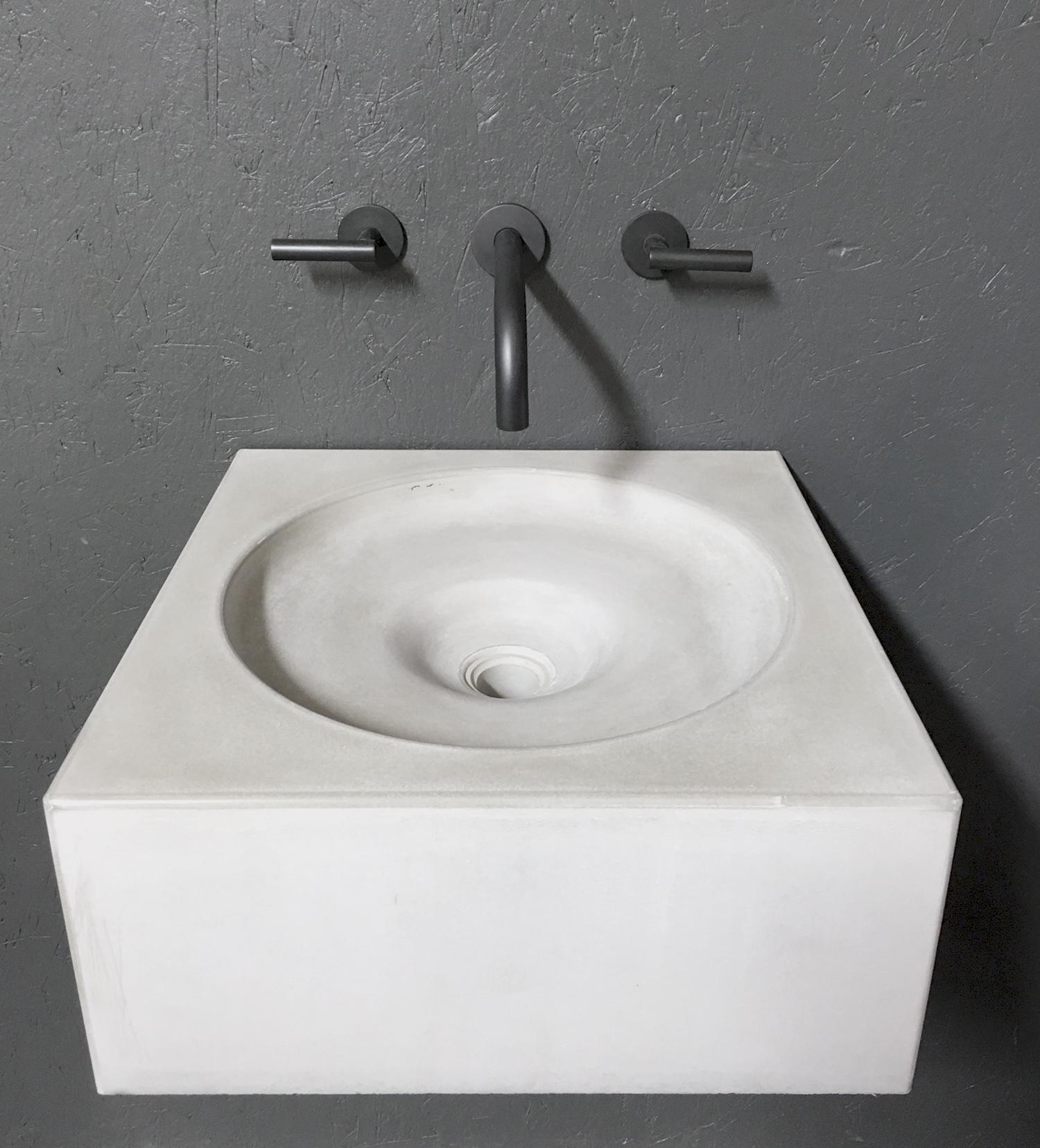 Concrete-sink-Black-taps.jpg