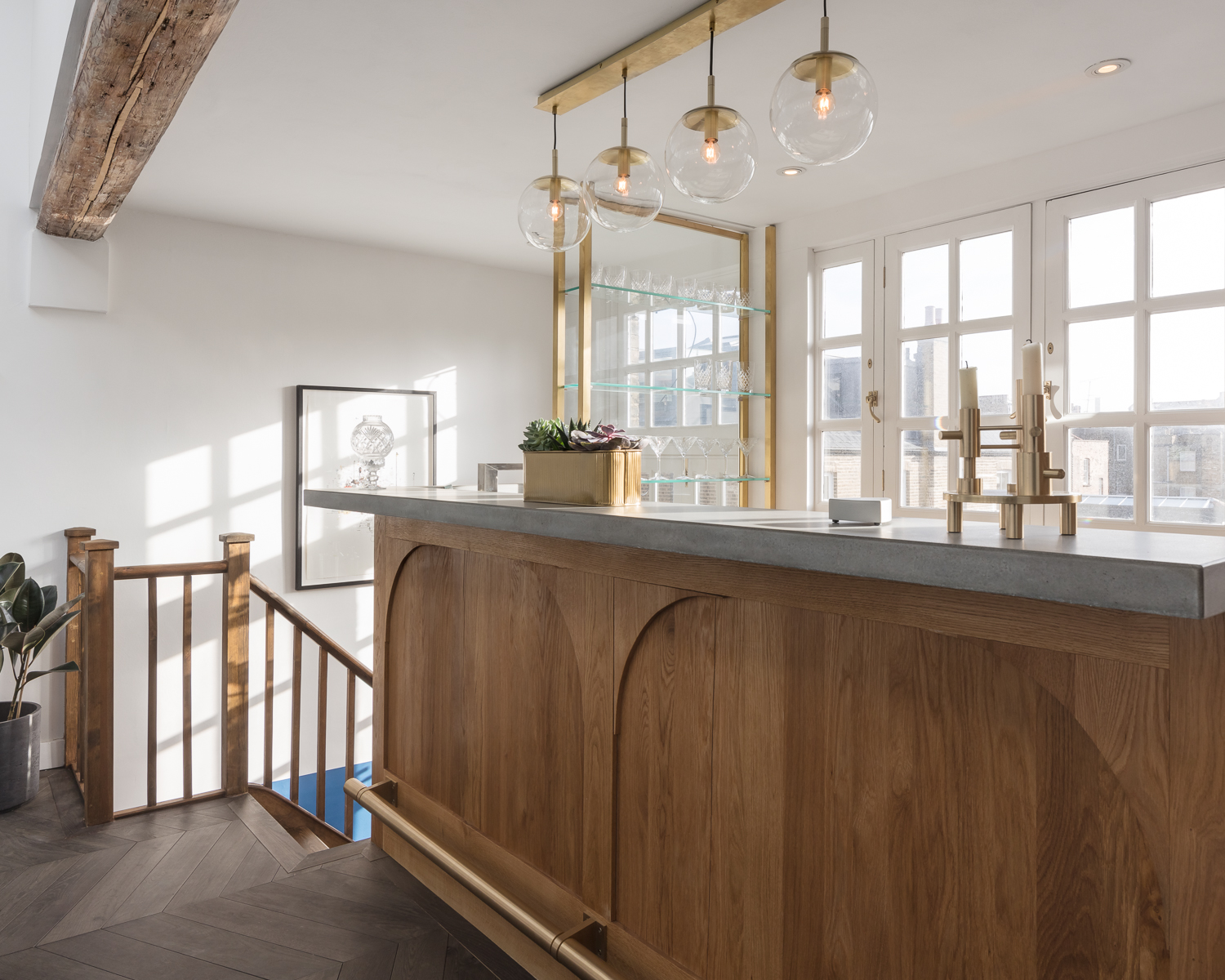 Our grey bespoke concrete worktop is beautifully offset by stunning brass work in this tough luxe interior in central London