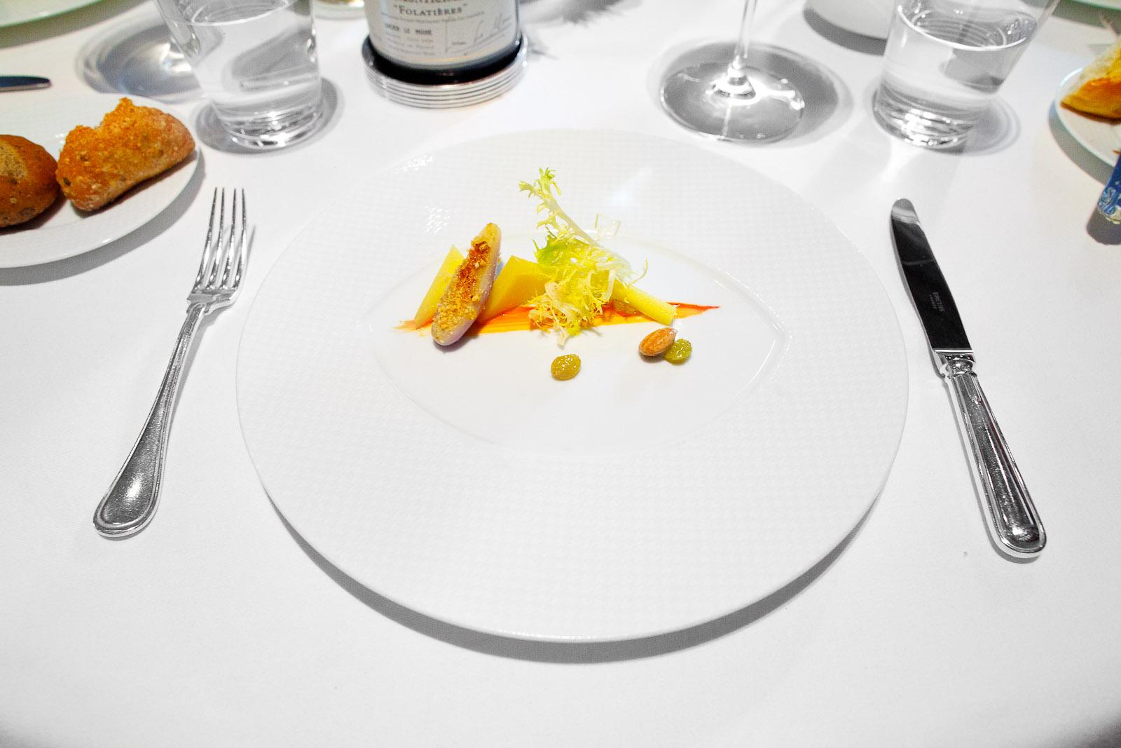 "8th Course - ""Comté Reserve,"" Eggplant, Sultana Raisins, Marcona Almonds, Frisée and Red Snapper Essence"