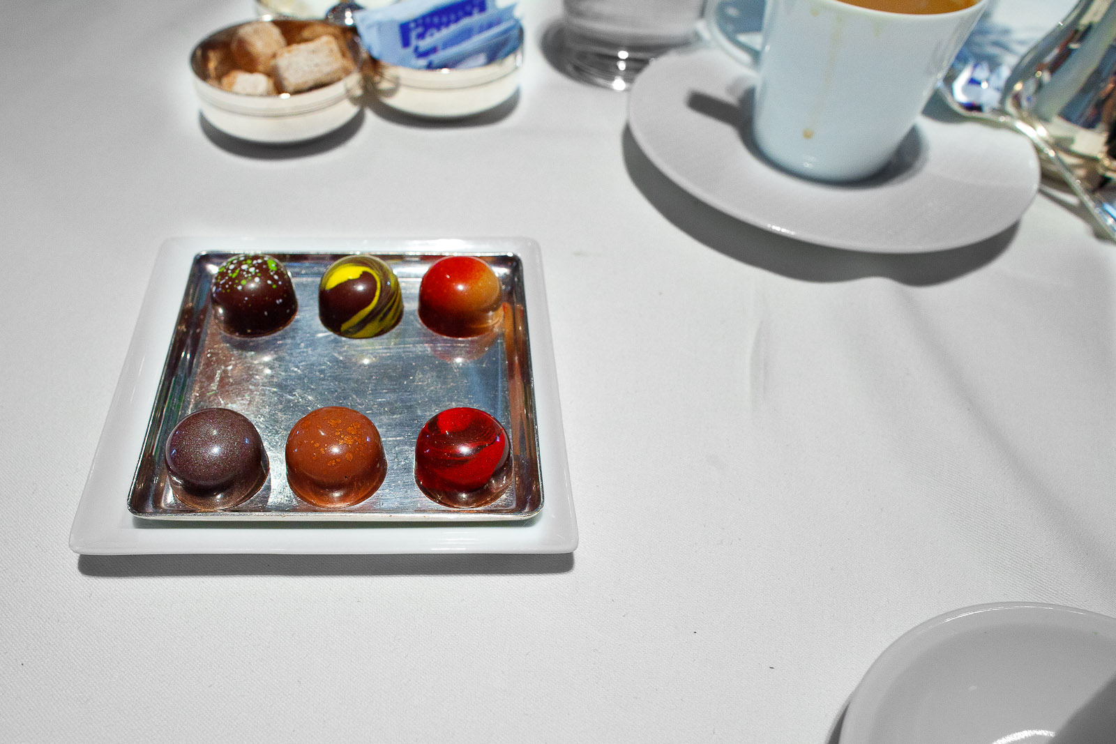 Mignardises- Chocolates - (clockwise) Olive Oil, Meyer Lemon, Peanut Butter and Jelly, Michigan Cherry, Hazelnut, Ginger