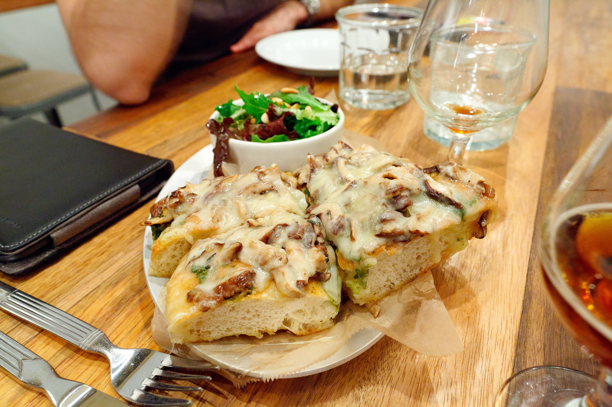 Fontina Val d'Aosta - Marinated mushrooms and basil pesto open-face on focaccia with green salad and toasted pine nuts