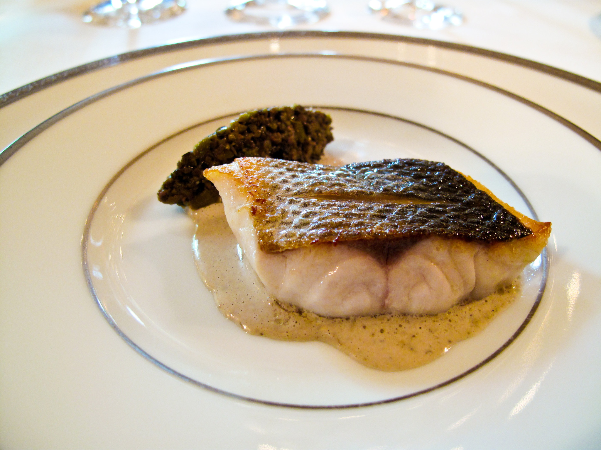 lAmbroisie-Sea-bass-with-olive-tapanade-amuse-bouche.jpg