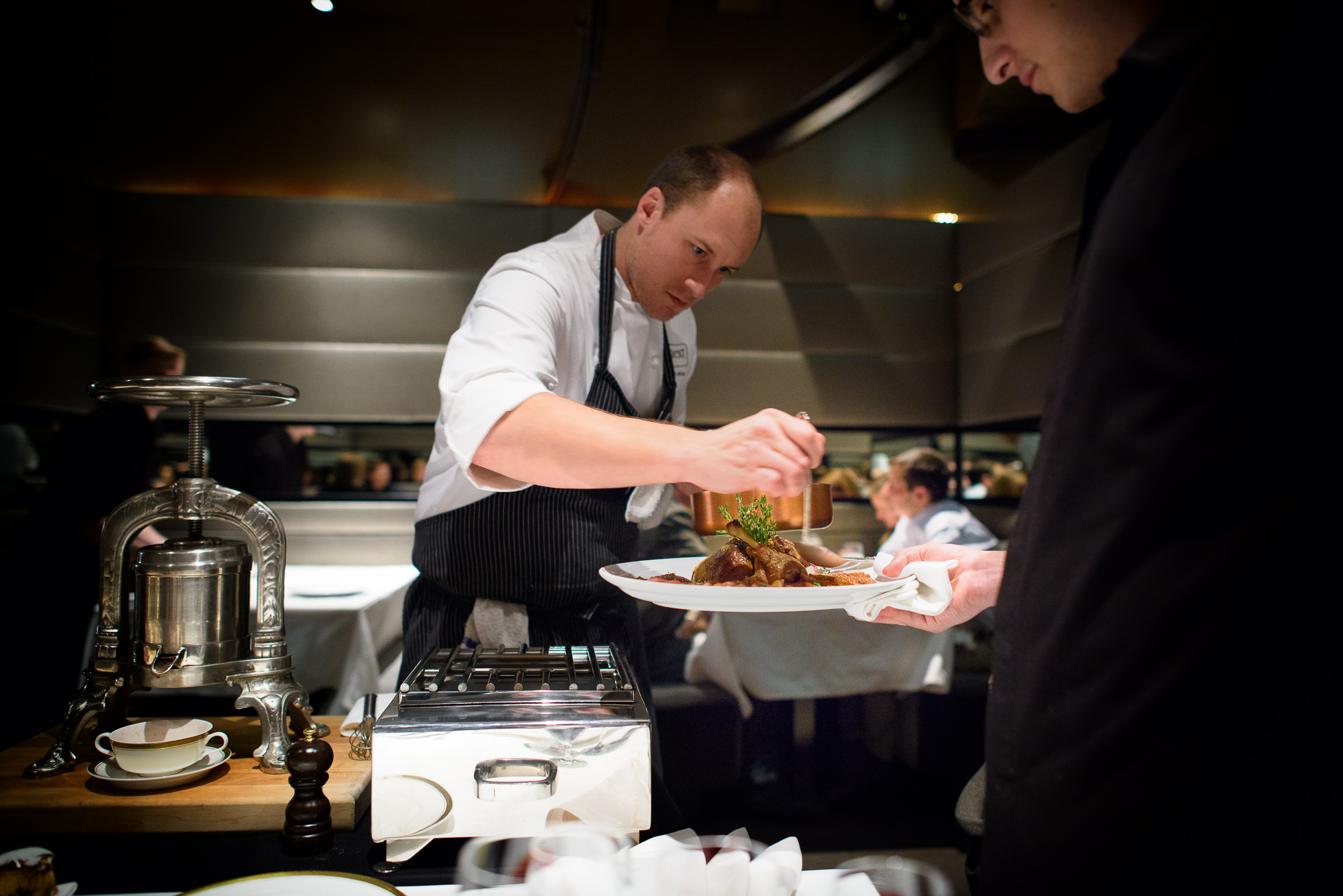 11th Course: Chef Dave Beran saucing the duck