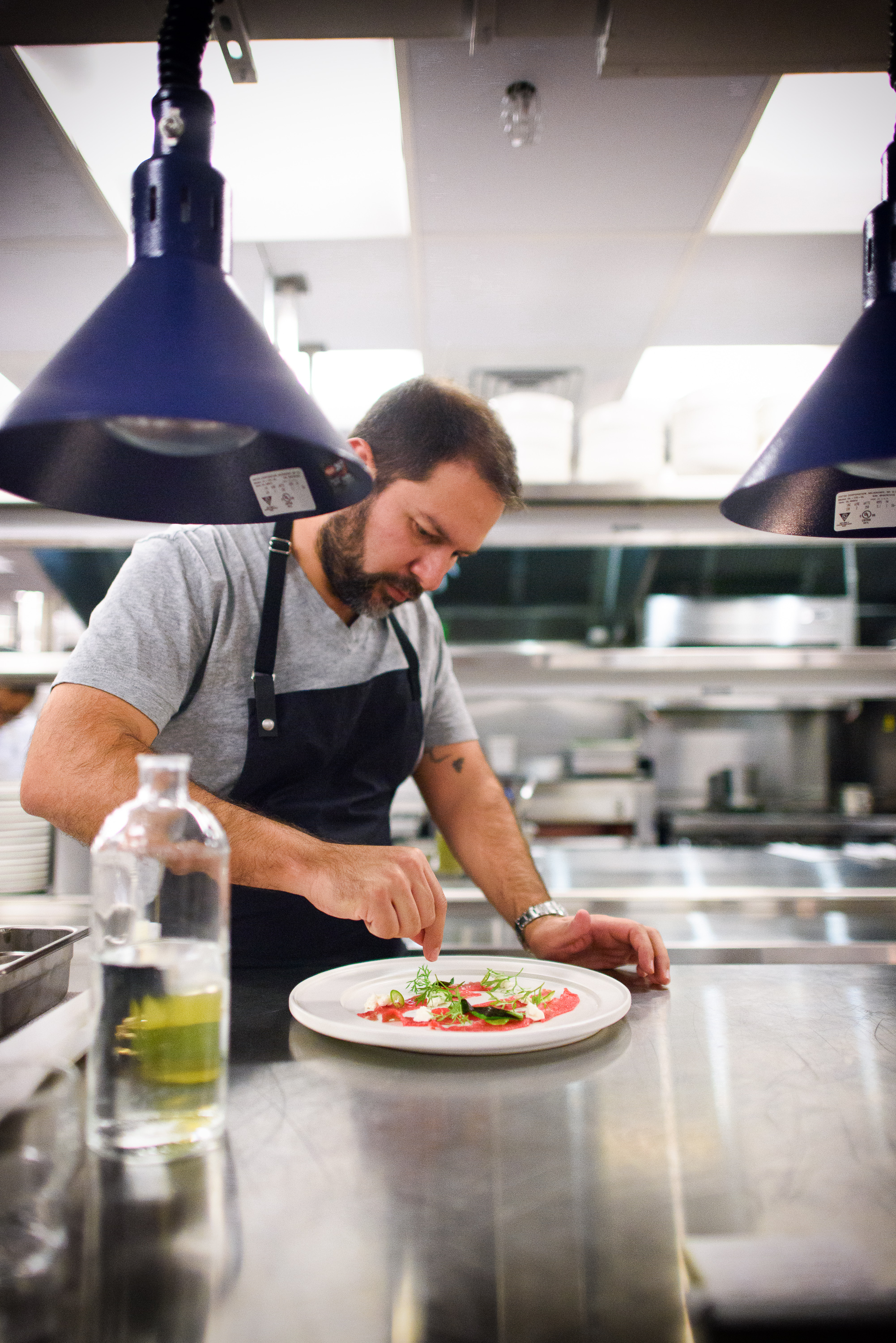 Chef Enrique Olvera finishing plating of the beef skirt caspacci
