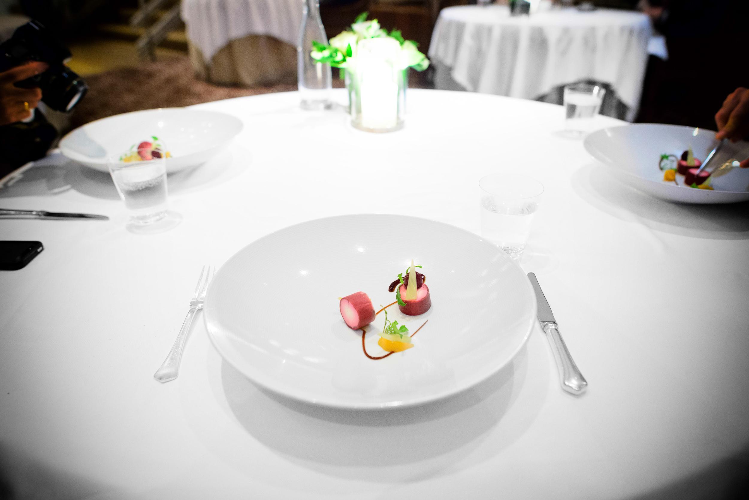 "16th Course: Andante dairy's ""cavatina,"" ruby beet crêpe, marin"