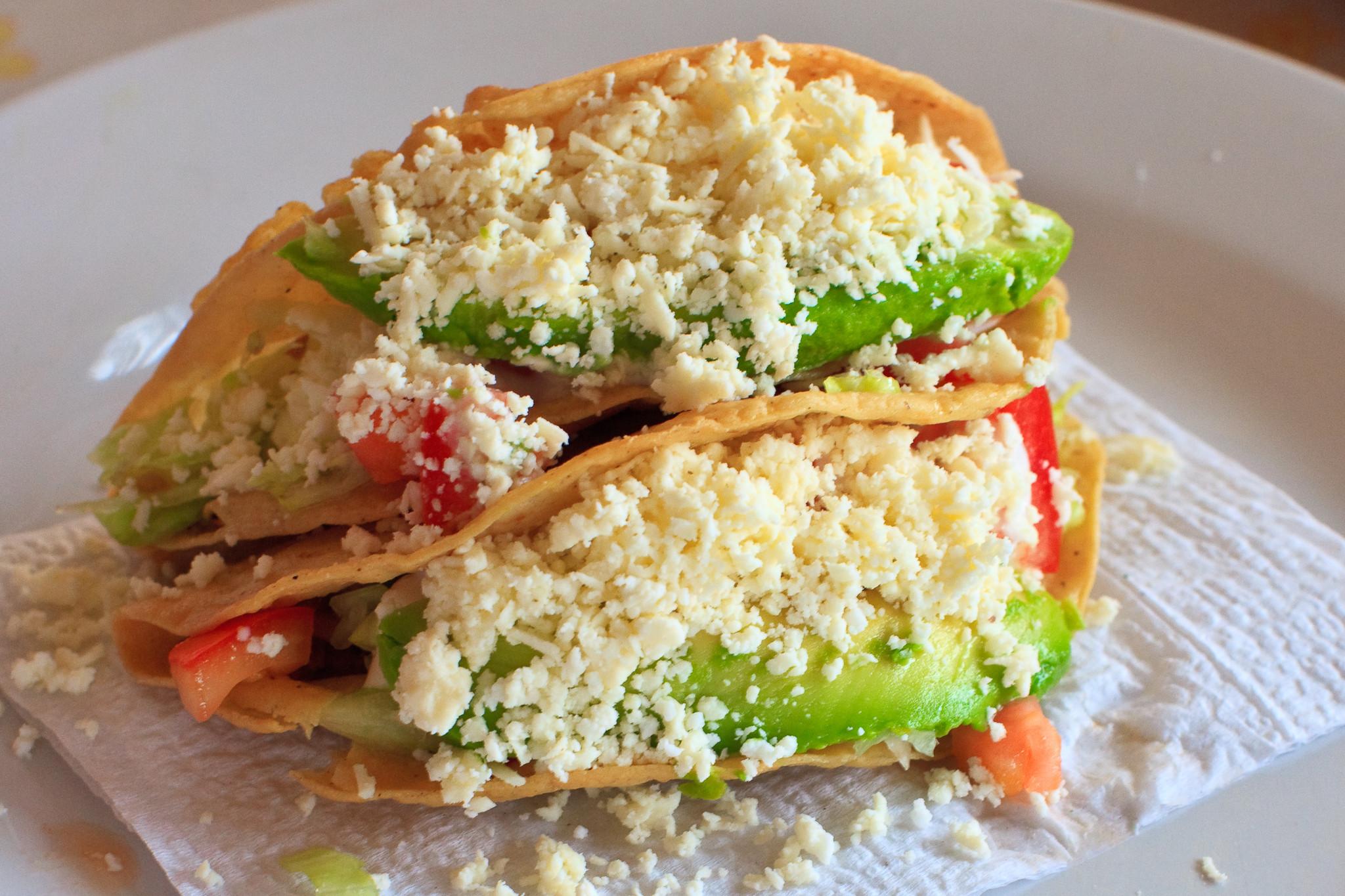 Los Tacos Dorados Up Close, Overflowing with Avocado