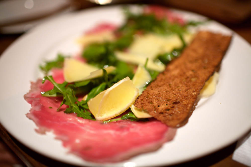 Veal Carpaccio with Capers, Almonds, Arugula, and Parmesan Cheese