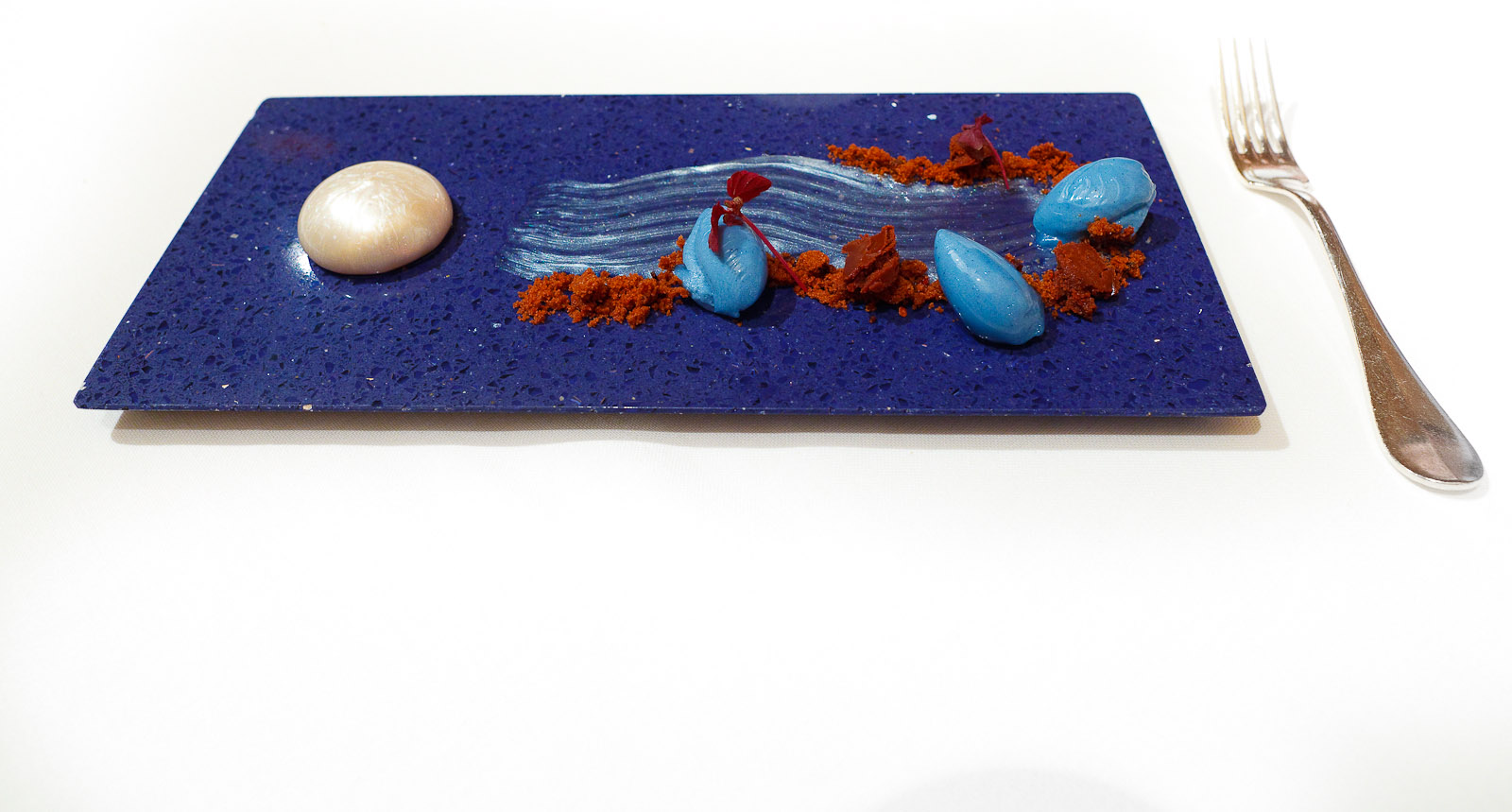 11th Course: Night and Day - Moon, coconut, rum, blue and black ganache