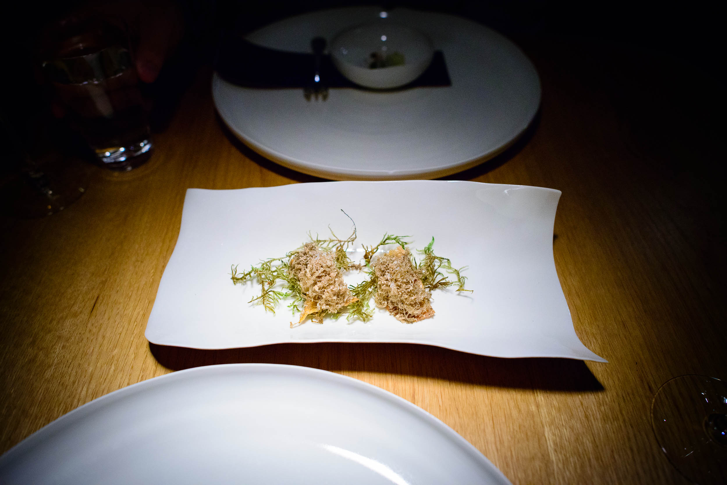 Deep-fried chicken skin with truffle cream, grated fermented por