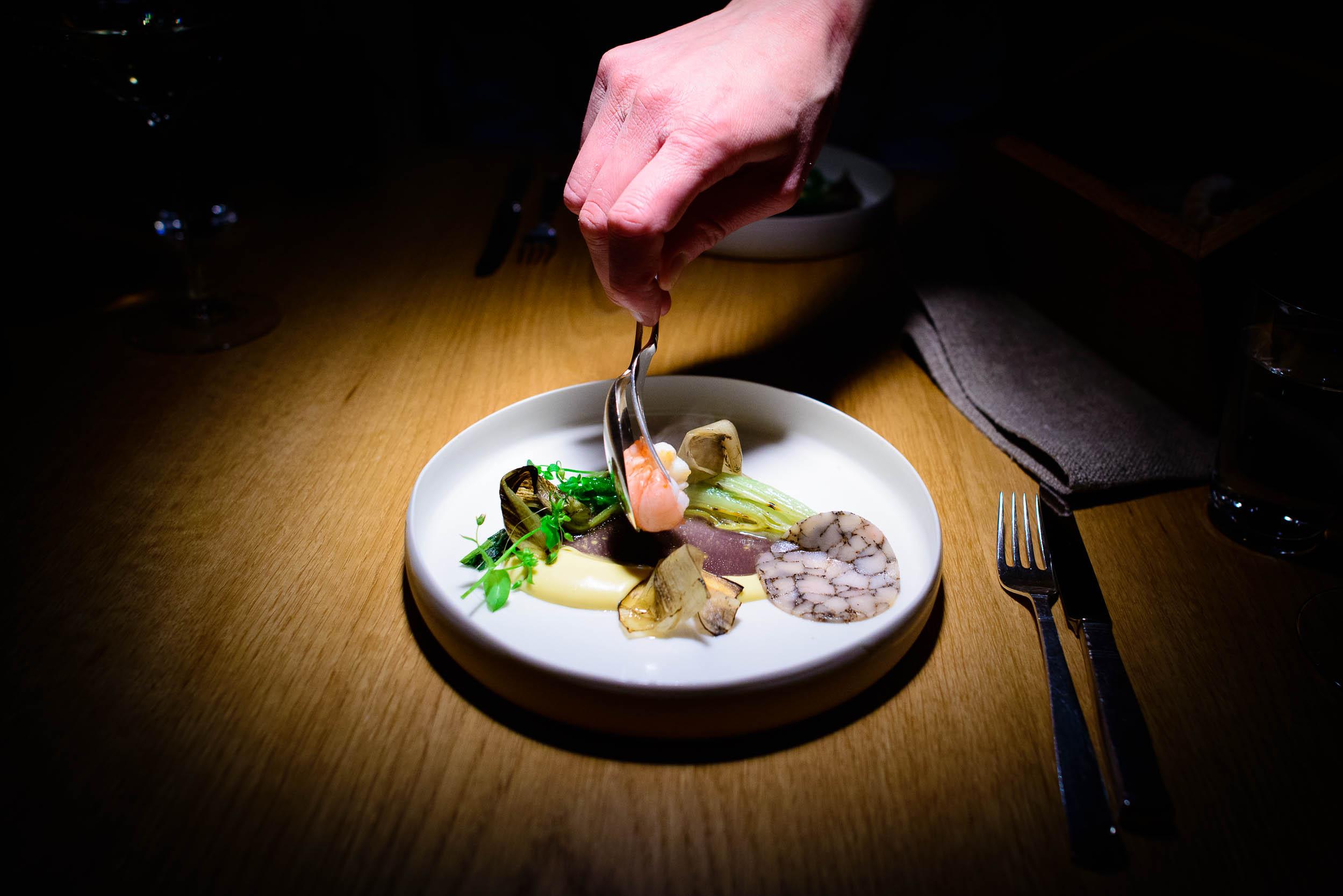 Herb grilled langostine with summer chanterelles, warm sour crea