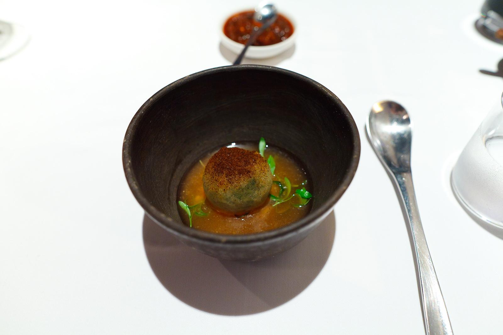1st Course: Bolita de quintonil y queso de cabra. Té de tomate, clavo, laurel, cilantro y chile chipotle. Dip de cebolla. Polvo de chile seco.