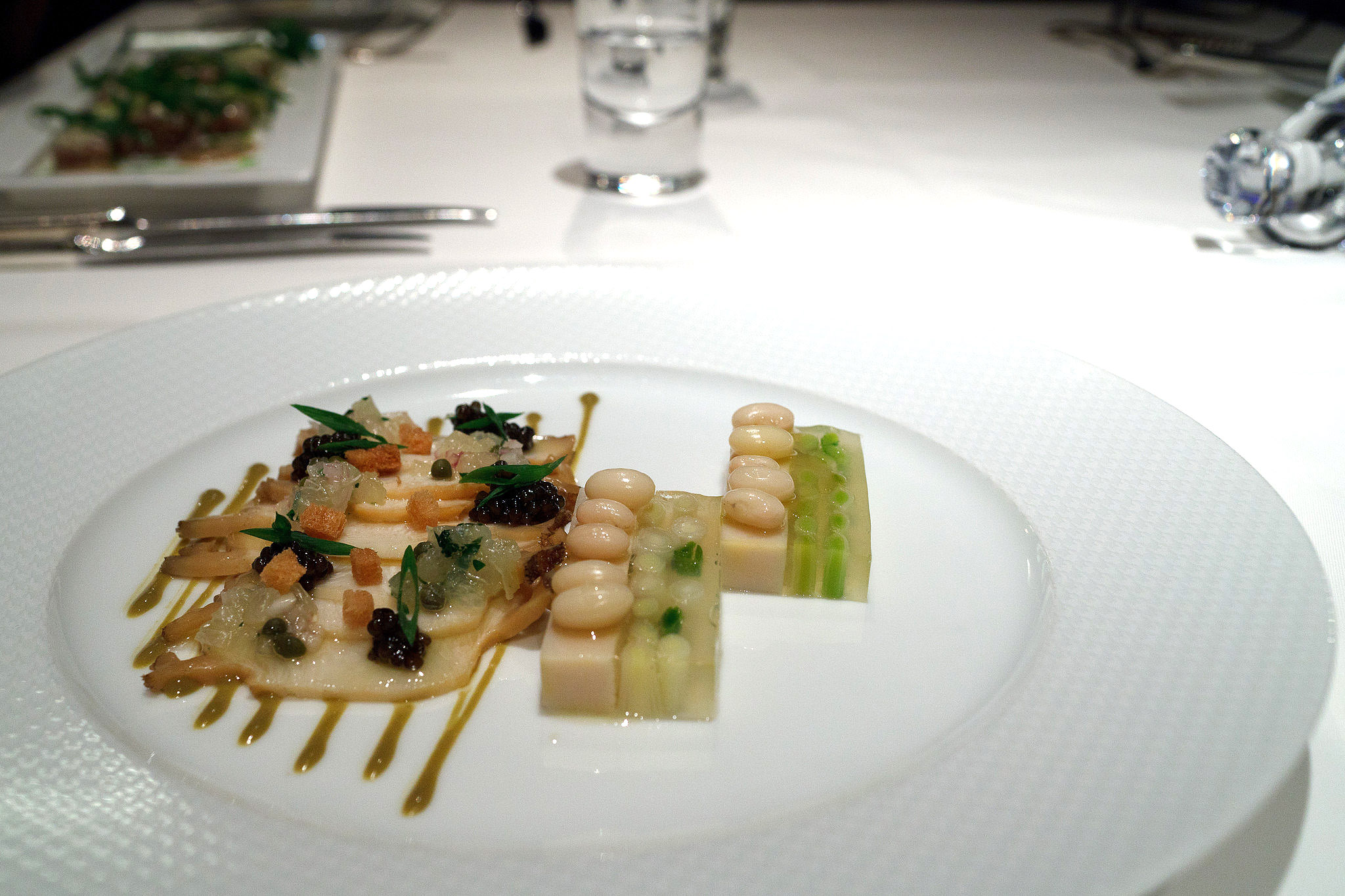 Signature, Tokyo - Warm abalone thinly sliced, white beans and leek terrine with caviar, lemon and caper, coral sauce