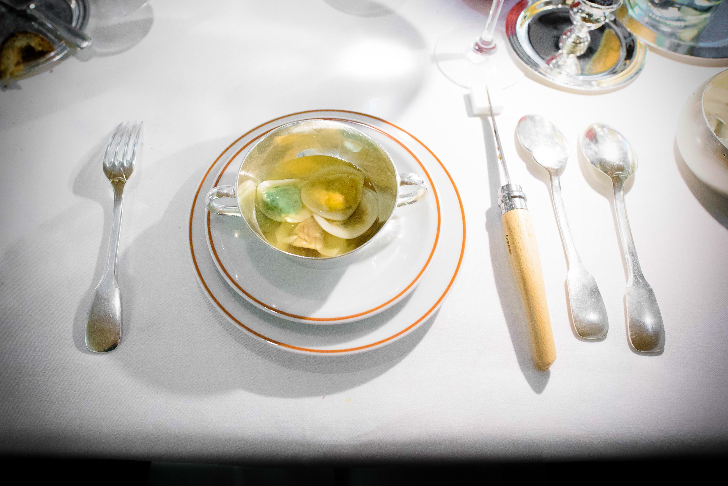 10th Course: Fines raviolis potagères multicolores, consommé v
