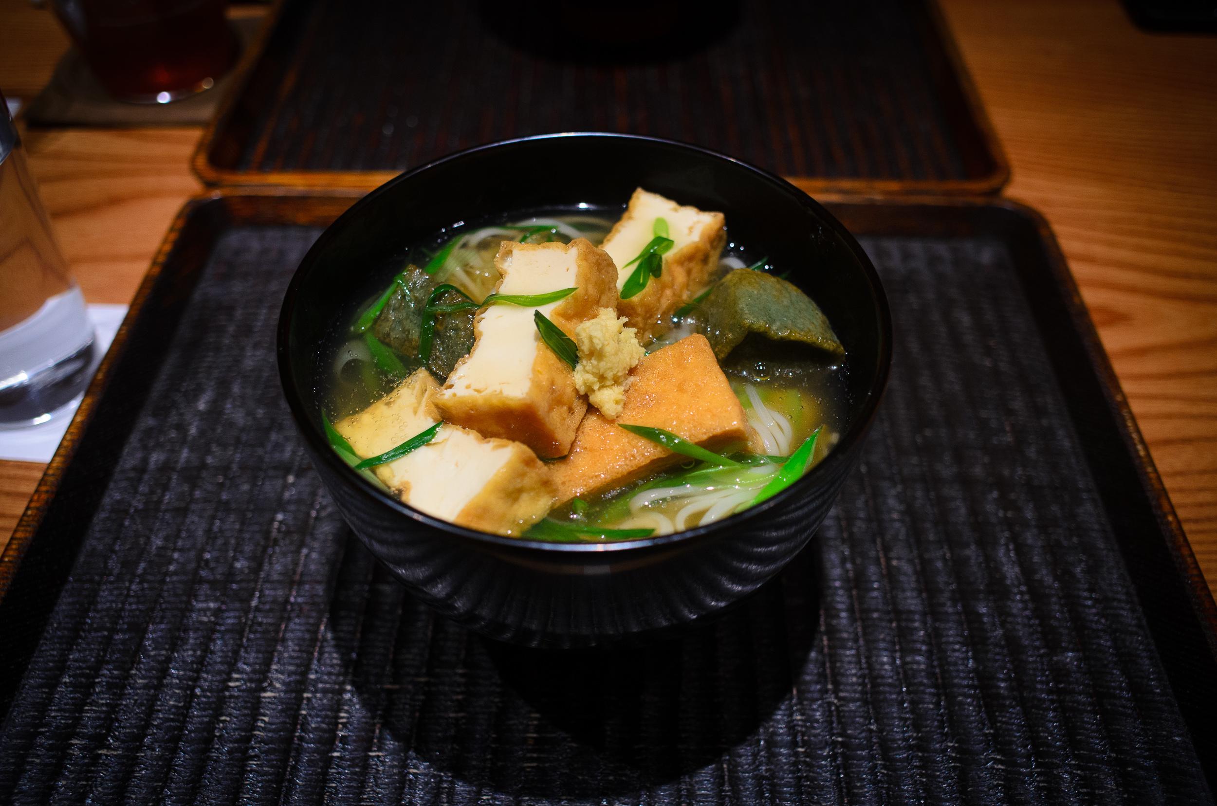 Tanuki udon - deep-fried tofu, yomogi-fu, scallion, ginger