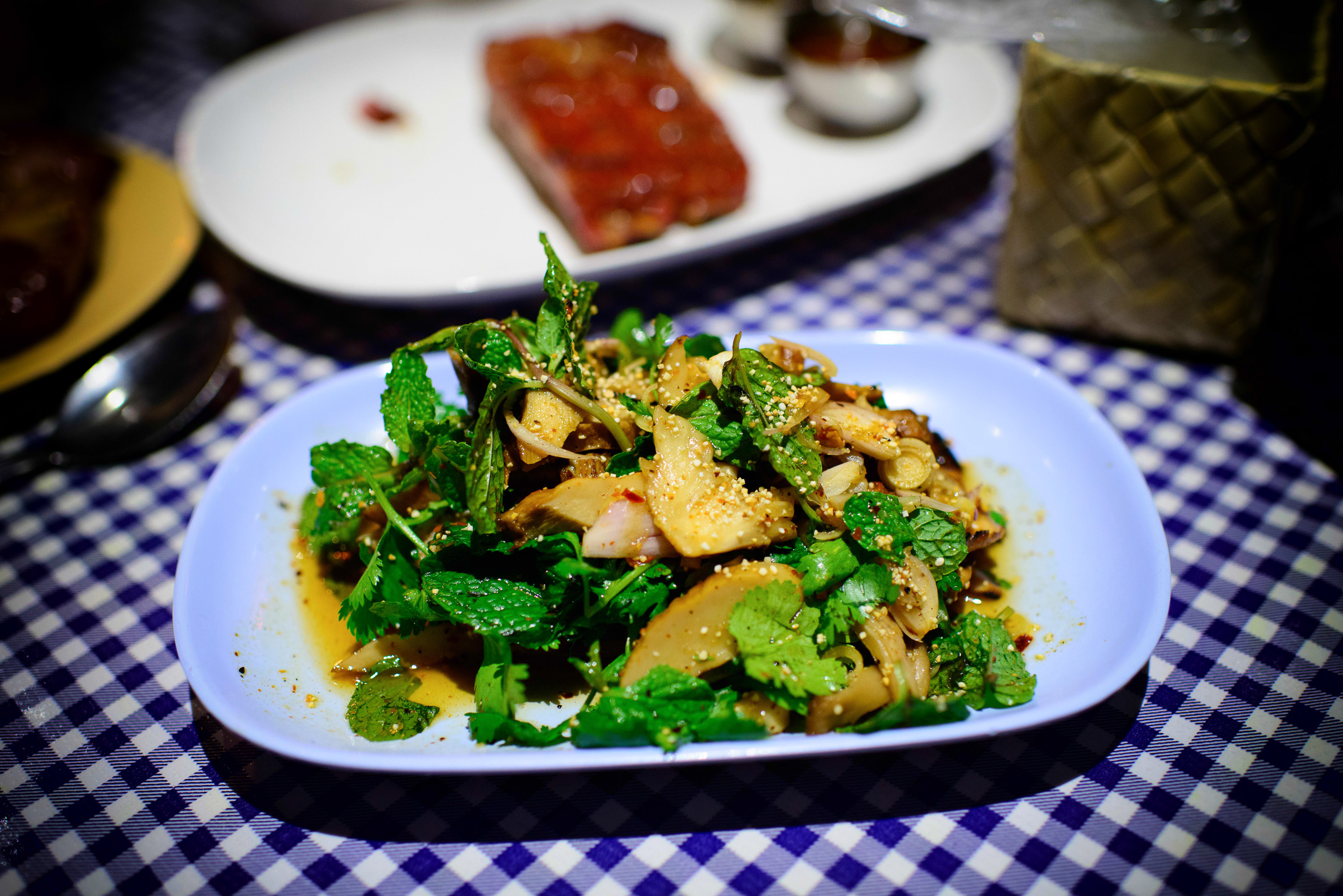 Het Paa Naam Tok - Spicy forest mushroom salad with soy sauce, l
